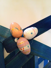 Photo: I rummaged through my craft supplies and came across these wooden Easter egg ornaments that I had purchased at a dollar store a few years ago.  I removed the strings and hot glued them on the basket handle.