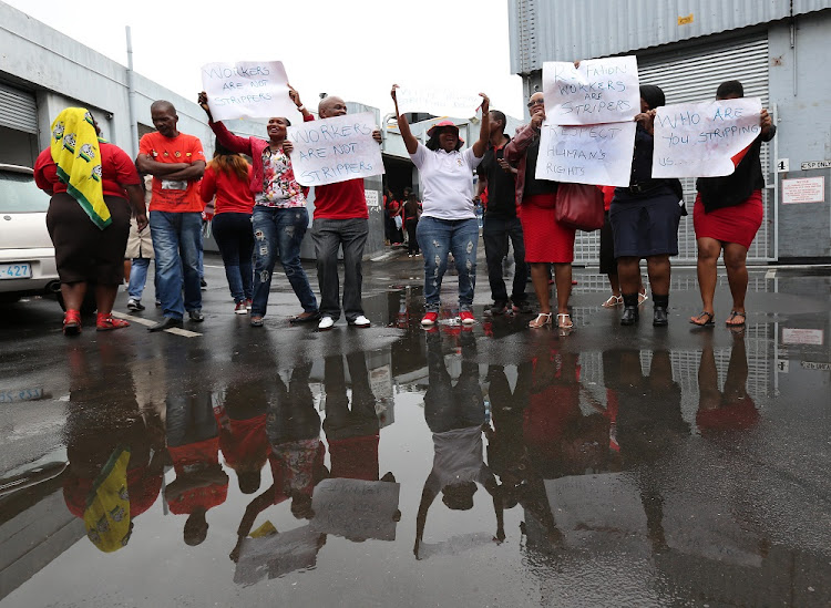 Cosatu members proteste outside factories in Sydney Road, Durban, where managers are accused of strip searching workers.