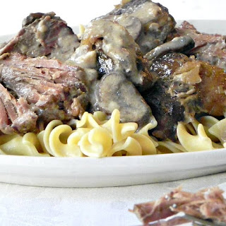 Easy Slow Cooker Pot Roast with Mushroom Gravy.