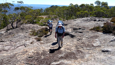 Photo: Ian Burridge leading them away from campsite after we picked up our packs On Fri 21st