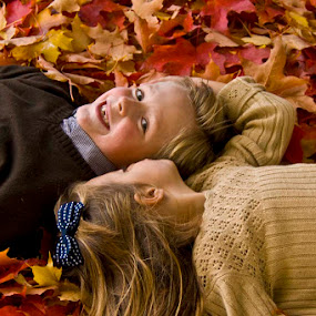 Sibling Love by Marie Browning - Babies & Children Children Candids ( love, fall, children, brown, leaves,  )
