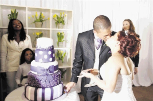 Flashback: The wedding of Derek Matthee and Gail Brookstein who had never seen each other until their wedding day in 2 Strangers and a Wedding - a Kaya FM competition last year. Pic. James Oatway. 30/05/2009. © ST. Cutting the cake... Wedding of