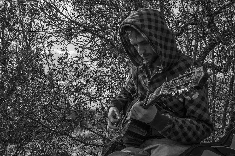 Sunday guitar playing by Miguel  Galvão - People Musicians & Entertainers ( évora, nature, male, white, acoustic, guitar, musician, portugal, woods, people, black, entertainer )