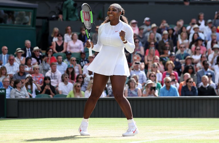 US player Serena Williams celebrates after winning against Italy's Camila Giorgi during their women's singles quarter-final match on the eighth day of the 2018 Wimbledon Championships at The All England Lawn Tennis Club in Wimbledon, southwest London, on July 10, 2018. Williams won the match 3-6, 6-3, 6-4.