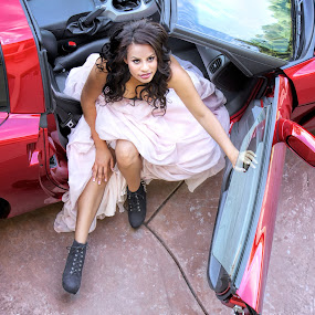 Beautiful Young African American Woman in a Fast Red Car by Kim Wilson - People Fashion ( car, model, fashion, person, exterior, automobile, one, beauty, people, photography, glamour, sexy, overhead, woman, pink, perspective, hair, black, skirt, young, angle, sensual, femininity, african american, red, female, horizontal, outdoors, images, bustier, outside )