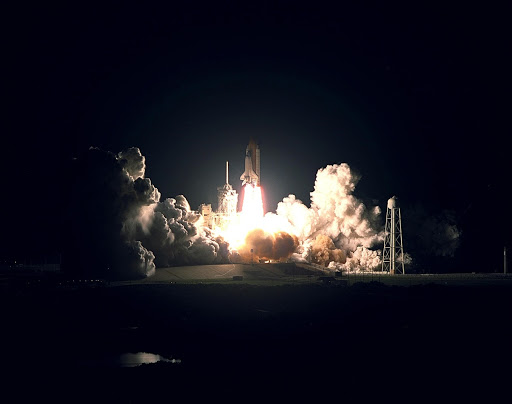 Space Shuttle Endeavour roars into the night sky in a perfect launch.