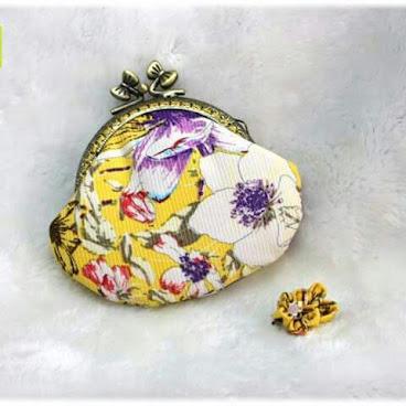 8.5cm 活潑黃色口金包