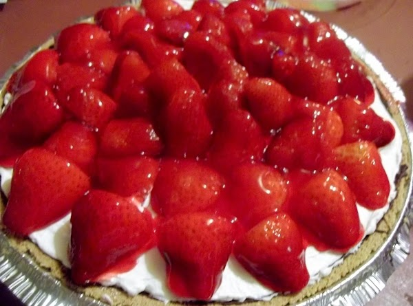 Arrange strawberries over pie. In a microwave, heat jam until melted; brush over the...