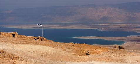 Photo: Israeli flag over Masada and Dead Sea