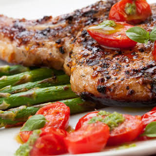 Grilled Pork Chops with Asparagus and Pesto.