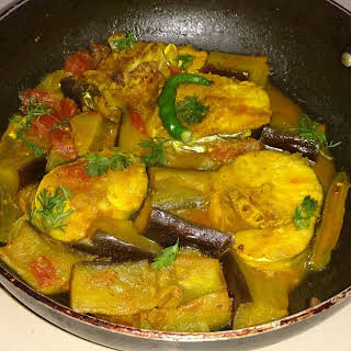 Aar Maacher Jhol - Giant river-catfish curry with eggplant.