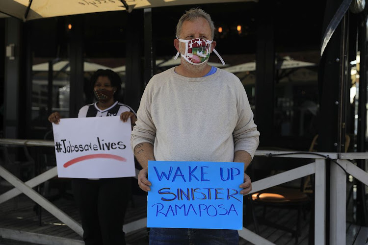 Restaurant workers protest in Parkhurst, Johannesburg, on July 22 2020. The restaurant industry called for one million seats placed on the streets around South Africa to protest lockdown regulations.