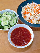 Photo: sweet-and-sour chilli sauce and other accompaniments