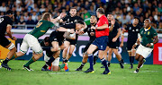 RG Snyman of South Africa looks to tackle Sonny Bill Williams of New Zealand (All Blacks) during the Rugby World Cup 2019 Pool B match between New Zealand and South Africa at International Stadium Yokohama on September 21, 2019 in Yokohama, Japan.