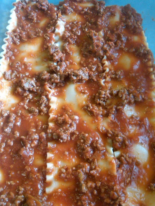 ...meat sauce...  (Add some canned mushrooms with this layer, if you're using them.)
