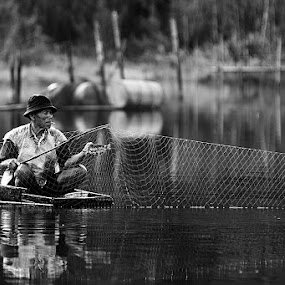 fisherman by Yongenz Youngz - People Portraits of Men