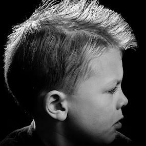 Mohawk Kid by Gregg Eisenberg - Babies & Children Children Candids ( child, black and white, back lit, white, pwcprofiles, mohawk, boy, portrait, black, pwcflashes, profile, strobe )