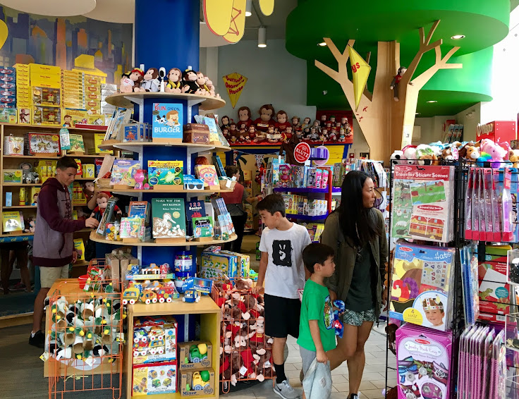 All sorts of fun in the Curious George Store.