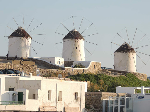 Three pretty windmills that line the waterfront in Mykonos, Greece.