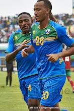 Photo: Djihad BIZIMANA (4) congratulates Hegman NGOMIRAKIZA (20) on his goal [Rwanda vs Morocco, CHAN - Group A, 24 Jan 2016 in Kigali, Rwanda.  Photo © Darren McKinstry 2016, www.XtraTimeSports.net]