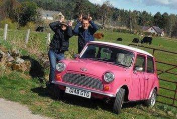 Pink mini in scotland with highland cows, england road trip adventure of a lifetime