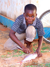 Photo: Mussa's brother cleaning a fish
