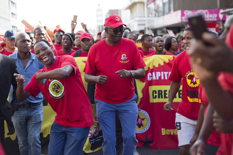 Members of Saftu with general secretary Zwelinzima Vavi, centre, during the May Day rally in central Durban. Picture: ROGAN WARD/THE TIMES