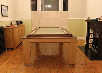 a vertical view of the spartan pool table with cream felt
