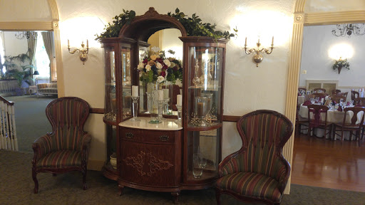 the china hutch and seating in the parlor