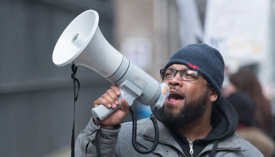 man with a megaphone calling people to action