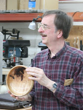 Photo: Gary Guenther shows a curly, silver maple bowl with bark inclusion.