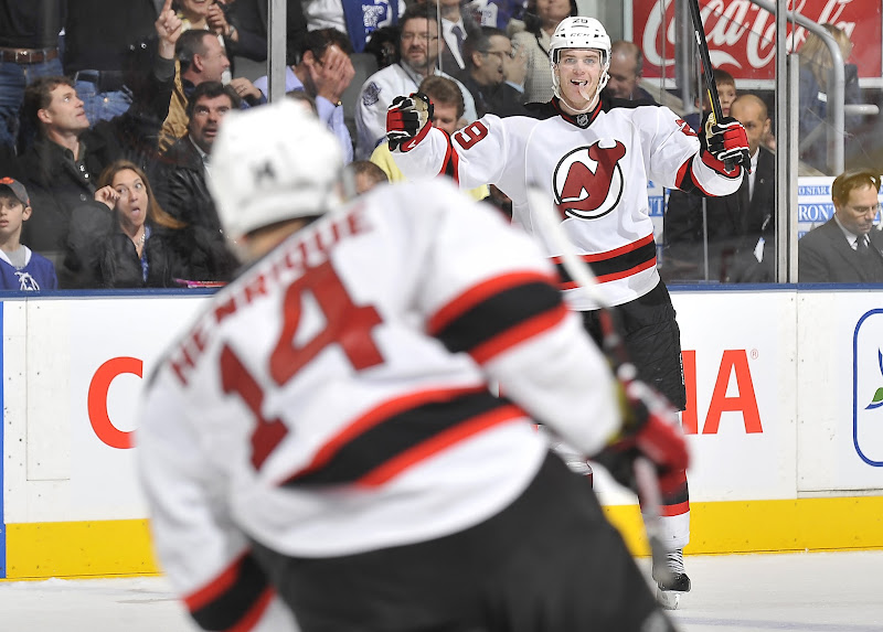 Photo: TORONTO, CANADA - FEBRUARY 21:  Mark Fayne #29 of the New Jersey Devils celebrates his overtime game winning goal against the Toronto Maple Leafs during NHL game action February 21, 2012 at the Air Canada Centre in Toronto, Canada (Photo by Graig Abel/NHLI via Getty Images)
