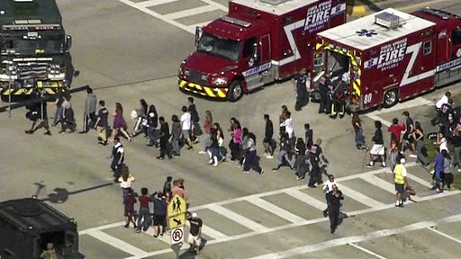 Students are evacuated from Marjory Stoneman Douglas High School in Parkland, Florida, US, during a shooting incident on February 14 2018, where school shootings are becoming increasingly common place. Picture: WSVN.COM VIA REUTERS
