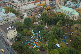 Photo: Bird's eye view of the Occupy Toronto protest at St. James Park in downtown Toronto. I've been hearing a lot in mainstream media that the Occupy movement is dying (they keep on focusing on that one small splinter cell that have been showing up on Bay Street in rather small numbers), but my visit to St. James completely made me think otherwise. Though I don't agree with all of your messages, I stand in solidarity with your movement and celebrate the freedoms you all have to peaceful protest.