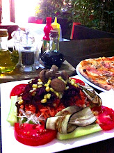 Photo: Food is cheap here.  In the best area of Skopje, $3 salad, $5 LARGE pizza.  With beers, our dinner was $15.  Wow.