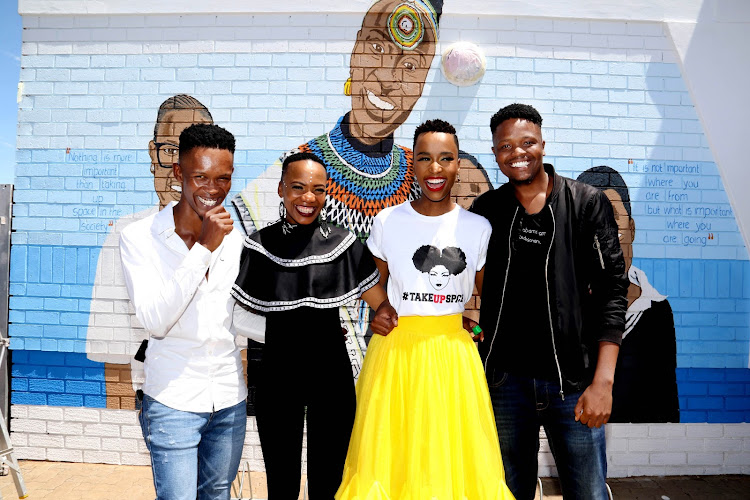 Miss Universe Zozibini Tunzi wears a #TakeUpSpace tee at the unveiling of a mural of her at the Nkosi Mtshazi Public Library in the Eastern Cape.