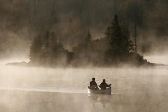 Photo: A canoe at dawn on the Lac Blanc the haze rised up because of the thermic gap between night and day temperature