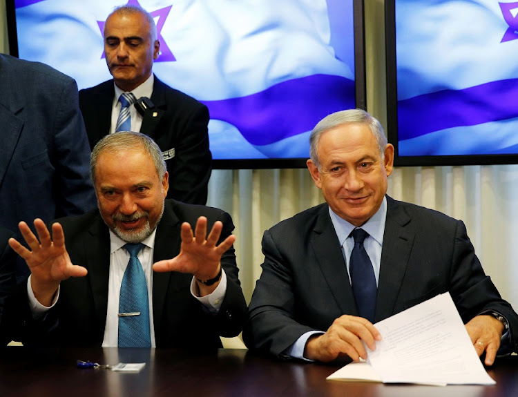 Israel's Defence Minister Avigdor Lieberman addresses a news conference with Prime Minister Benjamin Netanyahu in Jerusalem. Picture: REUTERS/BAZ RATNER