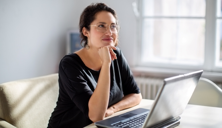 woman thinking about how to negotiate her job relocation package