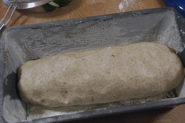 Shape the dough into a loaf and add to the baking dish.