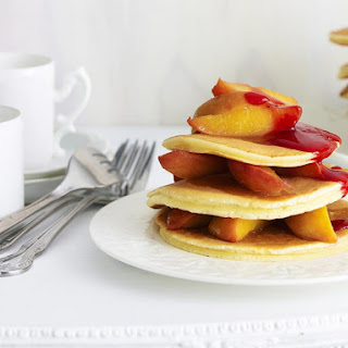 Pancakes with Peaches and Raspberry Puree.