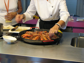 Photo: Putting the final touches on paella at La Boqueria's cooking school where we cooked our own almuerzo (main meal at 2-3pm)