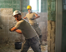 Photo: U.S. Air Force Staff Sgt. Jake Pudlick breaks tile off a bathroom wall at an elementary school in Ogulin, Croatia, June 24, 2014. The school bathrooms are being renovated by Airmen from the 133rd and 148th Civil Engineering Squadron, and 219th RED HORSE Squadron in partnership with the Croatian army. Croatia is a Minnesota state partner under the National Guard State Partnership Program. (U.S. Air National Guard photo by Staff Sgt. Austen Adriaens/Released)