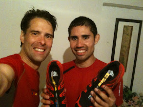 Photo: Richard Bolt and Mario Mendoza after running in a torrential downpour.