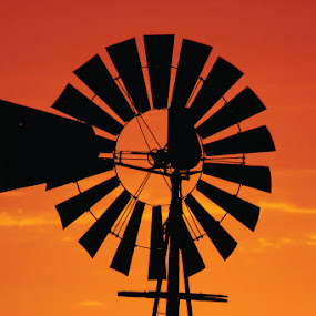 Wheel of life in a crimson sky by Kleintjie Loots - Products & Objects Technology Objects ( sunset, landscapes, close-up )