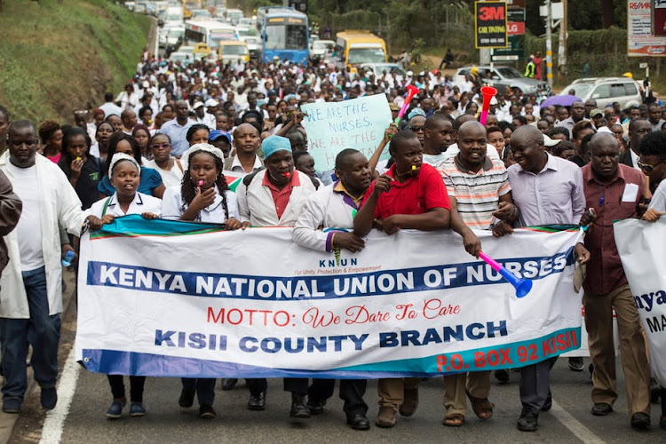 Striking Kenyan nurses take part in a protest in Nairobi.