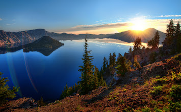 Photo: Exclusive first to Google+ I just took this a few hours ago… Sunrise over still lake  So, while on the way to Burning Man, I stopped up in the mountains of Oregon at Crater Lake, an extinct volcano that has been filled with fresh rainwater and snowmelt. Many of you here on Google+ recommended this, and I thank you very much.  I also made a behind-the-scenes video. I had a nice talk with +Bill Gross and he mentioned that people really enjoy watching me upload this stuff as it is happening… I guess he is probably right… or at least, maybe I can judge by the response here to this photo and the response to the upcoming video (if I can get it editing quickly!)  I'm now making my way to Burning Man… If I am slow in responding, I am sorry, but I will be reading ALL the comments as usual… and I very much enjoy getting to know you through your comments and your little avatar.  And, as always, you don't have to ask my permission to share a link to your own work or anything you might wish to offer up. Thank you.  Update I have edited the video, but I don't have enough bandwidth here at Burning Man to upload it! :( Does anyone knows a good internet connection here?  #SICInDatabase