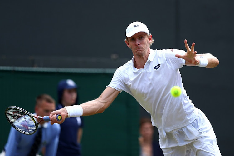 Kevin Anderson of South Africa plays a forehand against Roger Federer of Switzerland during their Men's Singles Quarter-Finals match on day nine of the Wimbledon Lawn Tennis Championships at All England Lawn Tennis and Croquet Club on July 11, 2018 in London, England.