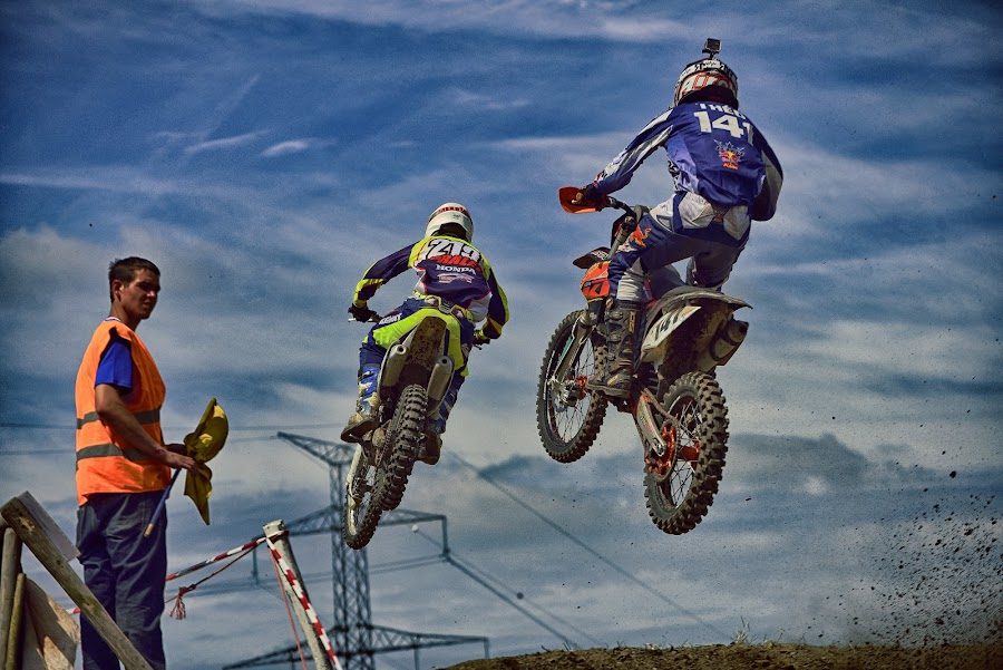 Jump Festival by Marco Bertamé - Sports & Fitness Motorsports ( clouds, 213, number, offical, race, jump, two, sky, motocross, blue, dust, clumps, air, one hundred forthy-one, two hundred thirteen, duel, man, 141, competition )