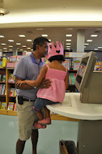 Photo: Mean while, Maddie and Daddy used the handy computer kiosk to look up some books on drawing, Maddie's favourite hobby.